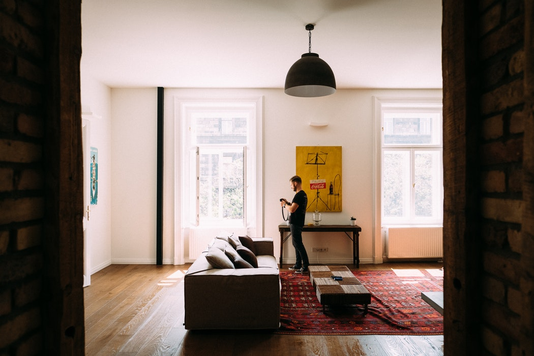 Apartment, living room, flat, man with a camera